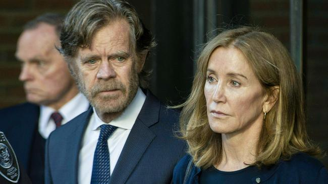 Huffman, escorted by her husband William H. Macy, exits the John Joseph Moakley United States Courthouse in Boston, where she was sentenced. Picture: Joseph Prezioso/AFP