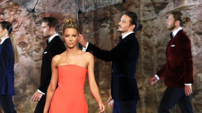 Tom Nunn from Queenscliff, on the right, shared the catwalk with big-name model Jennifer Hawkins at the Myer Autumn/Winter fashion launch at The Cutaway in Barangaroo. Picture: Toby Zerna