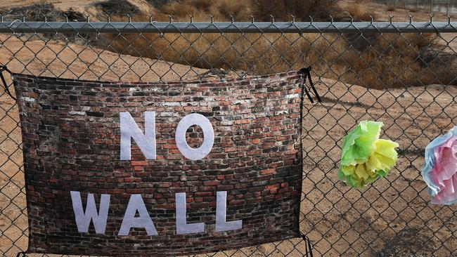 A sign adorns the fence near where the tent encampment for migrant children was built at the Tornillo-Guadalupe Port of Entry in Texas. Picture: Joe Raedle/Getty Images/AFP