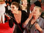 Dannii Minogue blows a kiss to the cameras with Nonna Paola as she arrives at the 57th Annual Logie Awards at Crown Palladium. Picture: Getty
