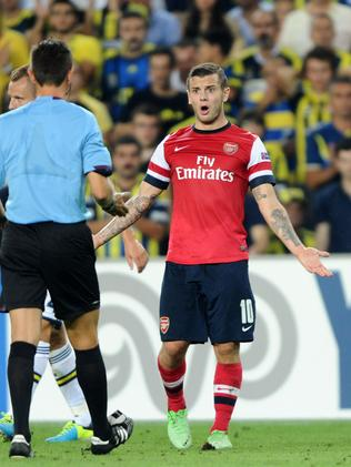 Arsenal's Jack Wilshere (R) reacts during their match with Fenerbahce's Raul Meireles (R) during their UEFA Champions League Play Off first leg match at Sukru Saracoglu Stadium in Istanbul on August 21, 2013. AFP PHOTO/BULENT KILIC