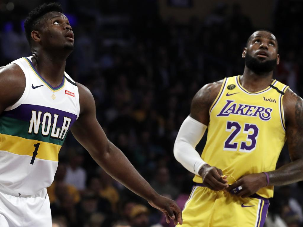 New Orleans Pelicans' Zion Williamson (1) looks on from under the basket during free throws next to Los Angeles Lakers' LeBron James (23) during the first half of an NBA basketball game Tuesday, Feb. 25, 2020, in Los Angeles. (AP Photo/Marcio Jose Sanchez)