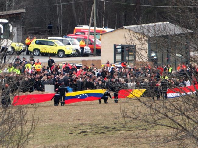 The dead ... Rescue workers hold up flags representing the nationalities of those killed on-board Germanwings flight. Picture: Patrick Aventurier/Getty Images