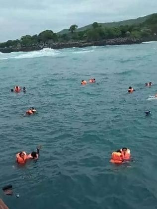 Dozens seen in the water wearing life jackets.