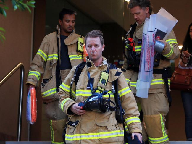 Firefighters leave the Turkish Consulate in Melbourne. Picture: Aaron Francis/The Australian