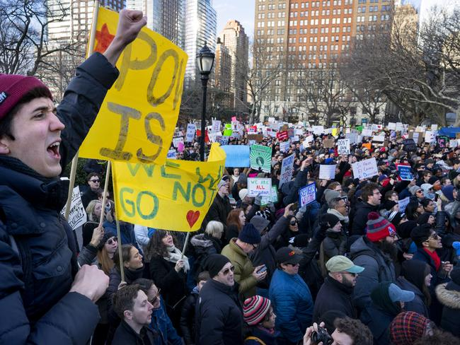 Protesters gather oppose the travel ban in New York's Battery Park on Sunday. Protests have been held at major airports around the country, including in Los Angeles, San Francisco, Boston, Michigan, Oregon, Dallas, Chicago and New York City. Picture: AP/Craig Ruttle