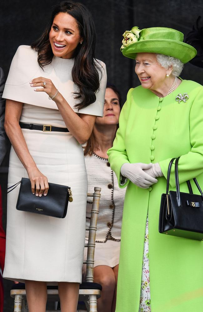 Newlywed Meghan, Duchess of Sussex and Queen Elizabeth II share a laugh together during a ceremony to open a bridge in Cheshire, England. Picture: Jeff J Mitchell/Getty Images