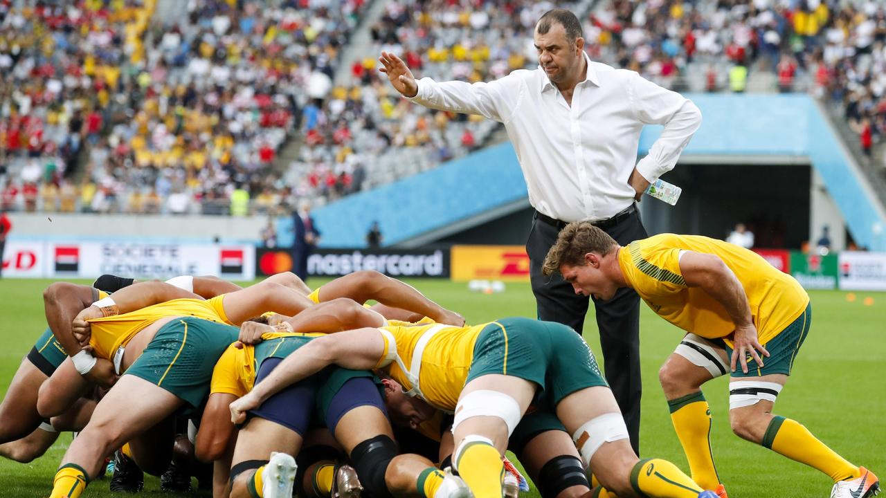 Michael Cheika watches his players before the Pool D match between Australia and Wales.