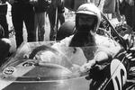 Sir Jack Brabham sports an artificial long ginger beard at the wheel of his car before the Dutch Grand Prix. Aged 44 at the time, he wore the beard in objection to the tag 'veteran driver' given to him by the world's press.