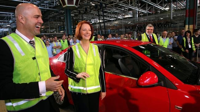 Glory days ... then PM Julia Gillard launches the Holden Cruze at the factory in Elizabeth with Mike Devereux.