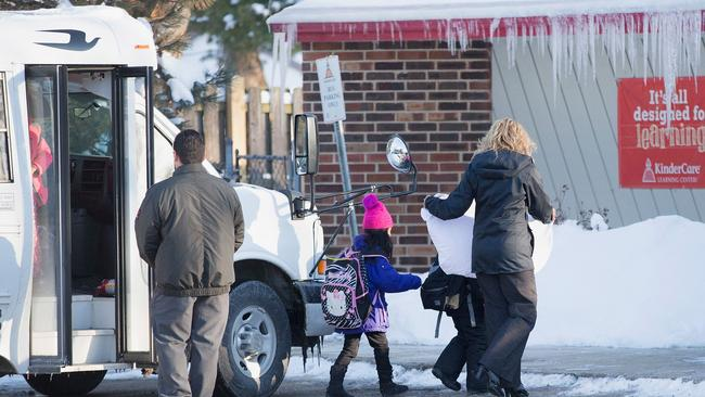 Children arrive at the KinderCare Learning Center on February 5, 2015 in Palatine, Illinois, where five infants were potentially infected with measles.