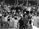 Crowds at Gepps Cross rush the car carrying Queen Elizabeth II from Parafield Airport to the city during her 1954 visit to Adelaide.