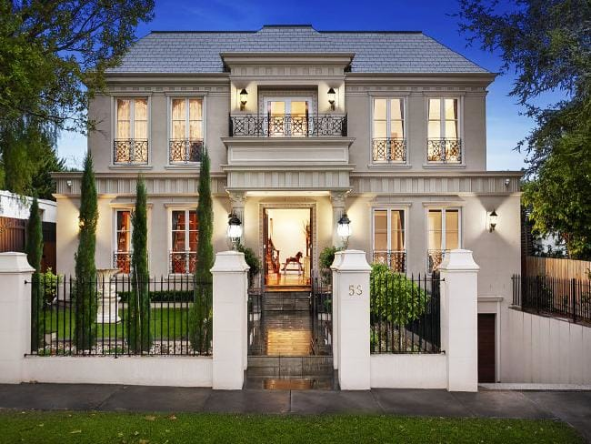 "This French provincial home Melbourne's eastern suburbs has a six-car garage. ""A French provincial house never had a double-car garage in the facade,"" Melbourne University Professor Philip Goad says. ""A French provincial house never had a car."""