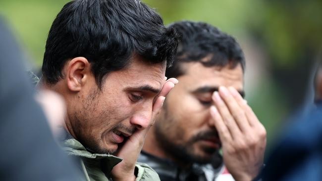 Friends and family of the victims wait near Christchurch Hospital for news. Picture: Getty