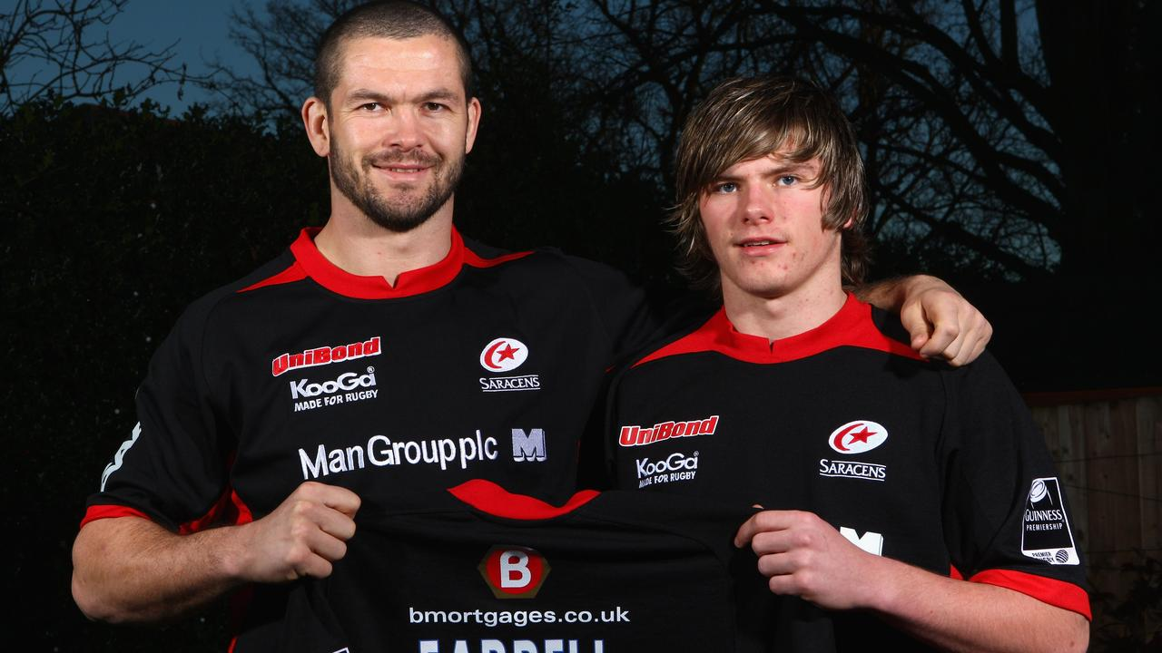 Andy Farrell with son Owen as a 16-year-old signing for Saracens in 2008.