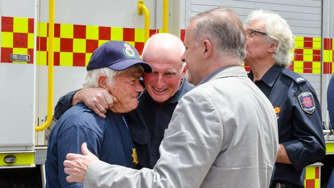 Federal opposition leader Anthony Albanese visits Cudlee Creek CFS following devastating bushfires in the area, Saturday, November 4, 2020. Fulltime volunteer firefighter Mike Larecki, left, who has been deployed to Queensland, NSW and Vic this season, broke down when talking about his experiences to Albo and Cudlee Creek CFS Captain Mark Hawkins. Photo: Brenton Edwards.