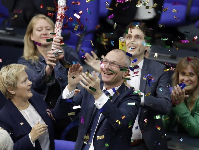Green Party's gay rights activist Volker Beck, front right, and fellow faction members celebrate with a confetti popper after German federal Parliament voted to legalise same-sex marriage in Berlin. Picture: Michael Sohn