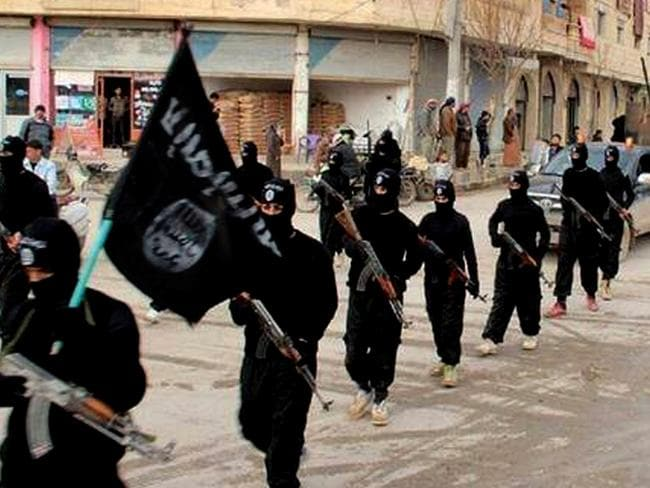 Fighters from the al-Qaida-linked Islamic State of Iraq and the Levant (ISIL) marching in Raqqa, Syria earlier this year. Picture: AP