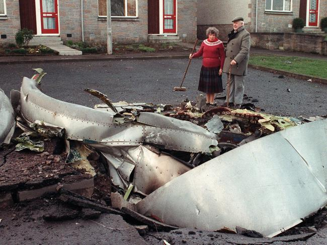 Lockerbie villagers stand next to wreckage from Pam Am Flight 103 after the Boeing 747 was downed en route to New York on December 22, 1988, killing 270. Picture: NewsLtd