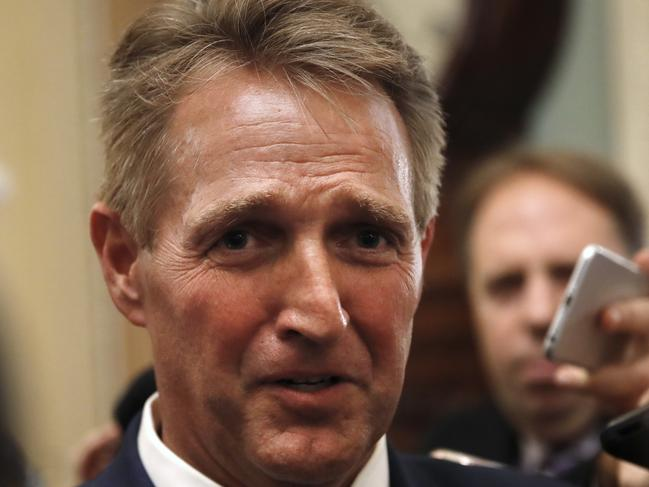 Senator Jeff Flake is questioned by reporters about Supreme Court nominee Brett Kavanaugh. Picture: AP