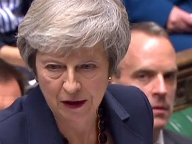 Desperate times...Theresa May at question time as the Brexit Secretary Dominic Raab watches on.