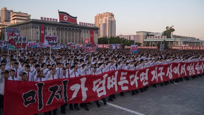 Students march during a mass anti-America rally on Kim Il-Sung square in Pyongyang on September 23. Picture: Kim Won-Jin