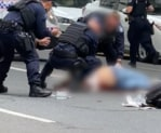 A man was shot dead in Brisbane after allegedly approaching police with a knife.