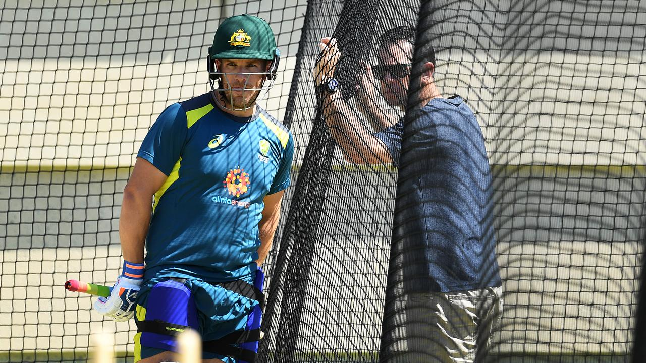Australian batsman Aaron Finch (left) receiving advice from Ricky Ponting ahead of the second Test against India in Perth.