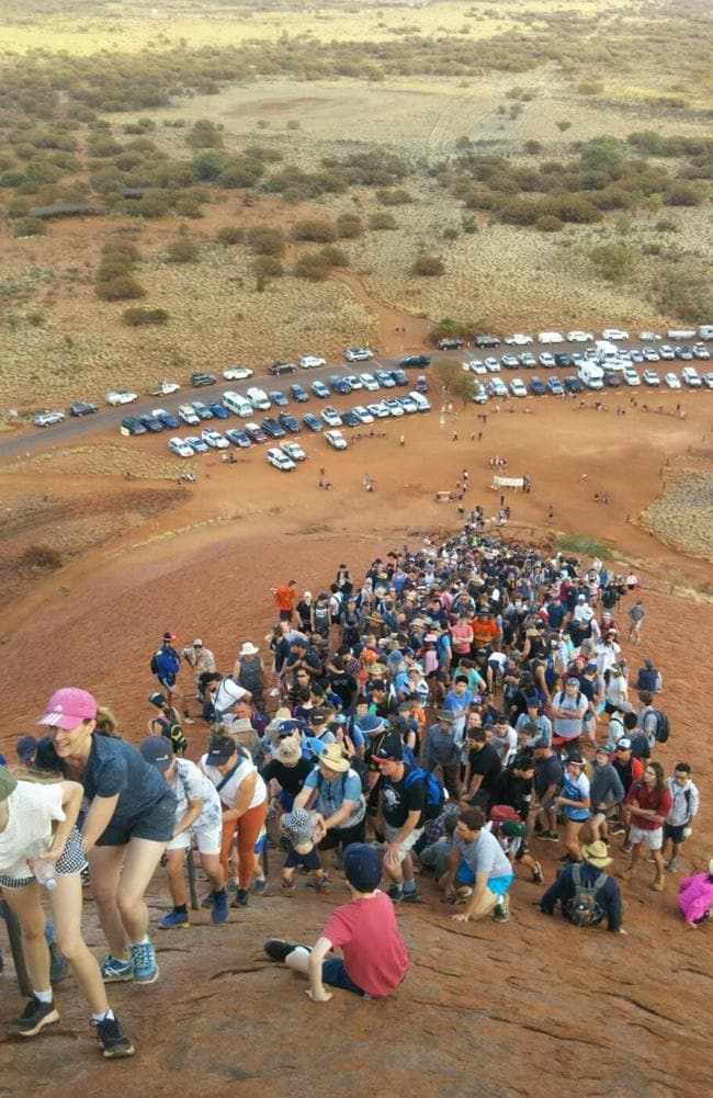 People have flocked to climb the landmark before the practice is banned. Picture: Supplied