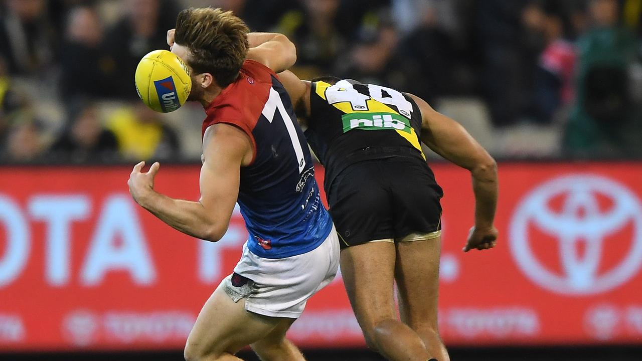 Jack Viney is collected by Sydney Stack at the start of the fourth quarter on Wednesday night. (AAP Image/Julian Smith)