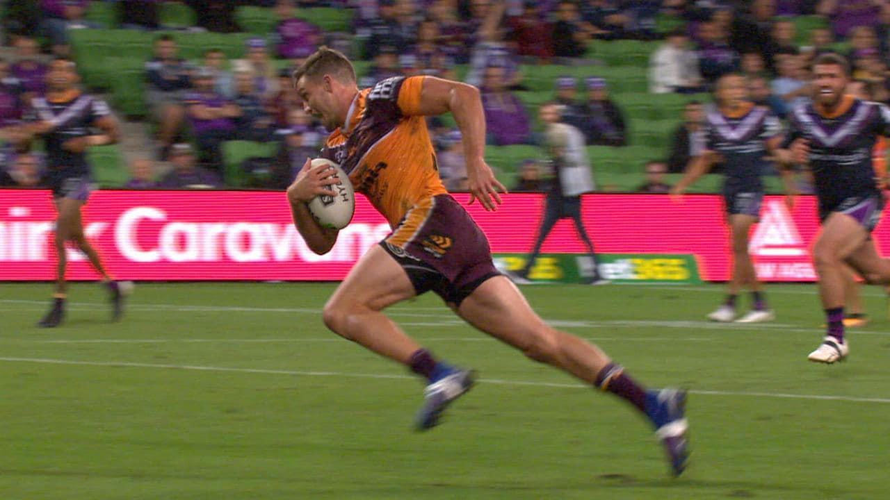 Corey Oates of Brisbane scores after Bromwich's offload