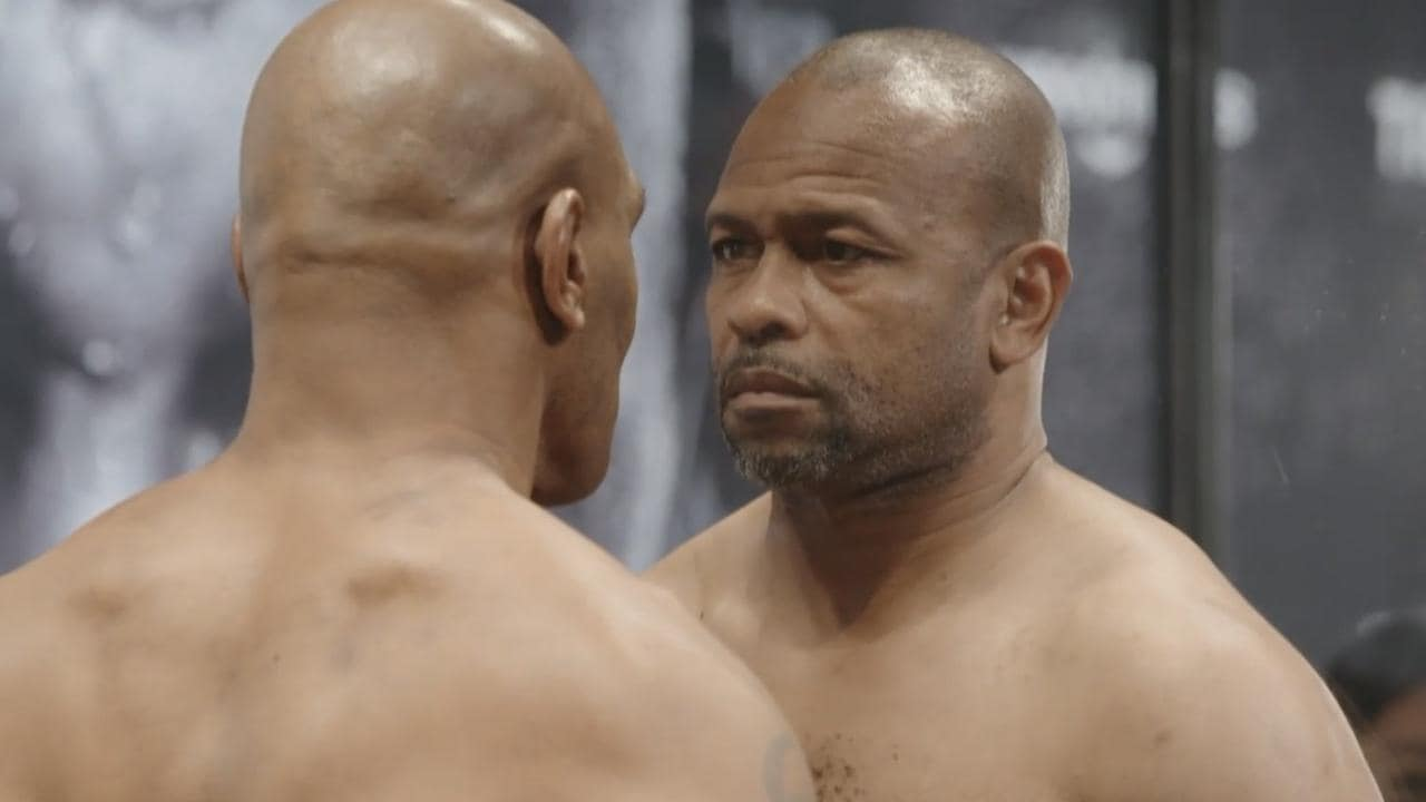 Mike Tyson and Roy Jones Jr. face off at the weigh-in.