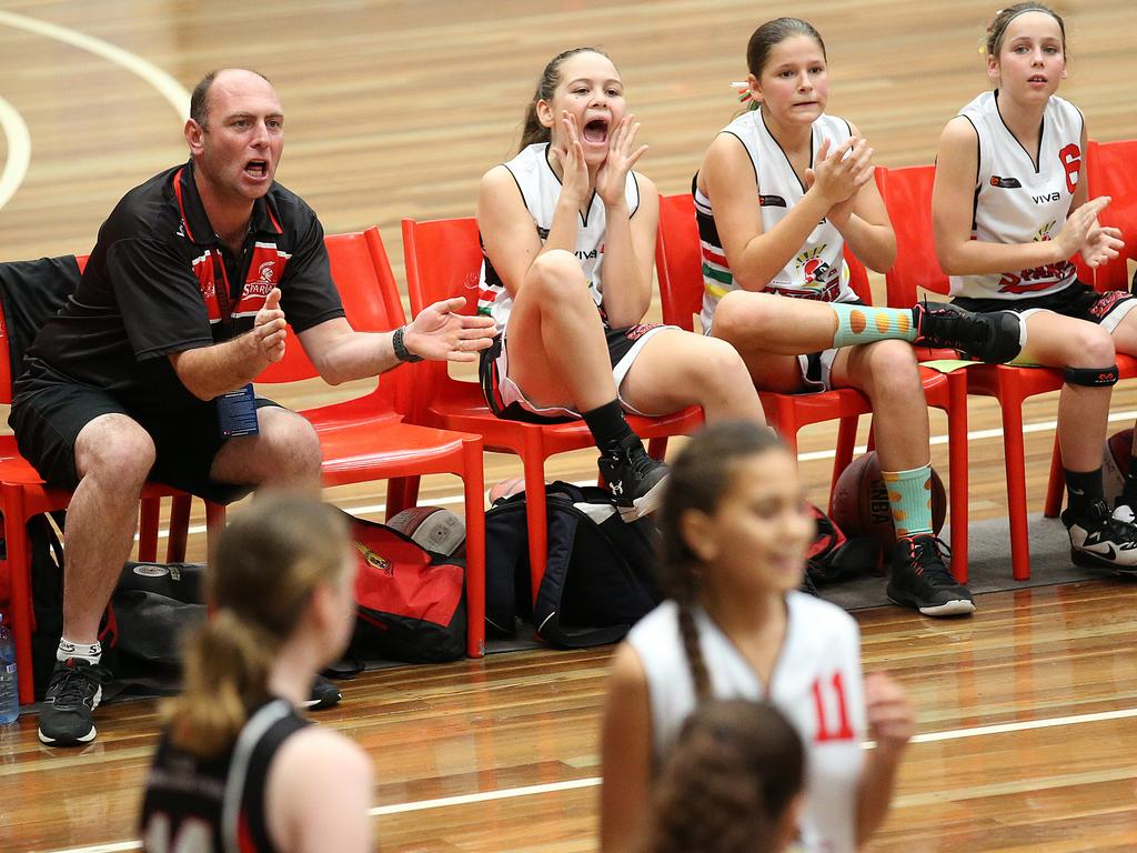 Spartans players cheer at the under 12 girls QBL basketball tournament in Brisbane during a game in 2019. It could be moments like these which could be missed by parents and grandparents under new government guidelines for community sport during COVID-19. Picture: Jono Searle/AAP