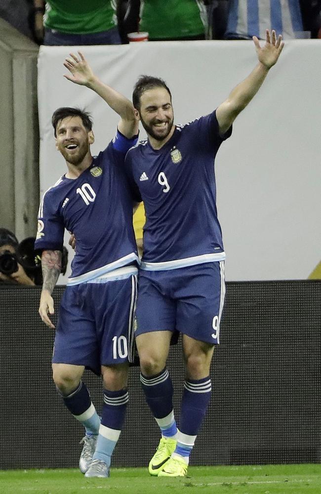 Argentina forward Gonzalo Higuain (9) celebrates with Messi.