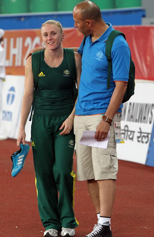 Happier times: Eric Hollingsworth with a comforting arm around the shoulder of Sally Pearson in 2010.