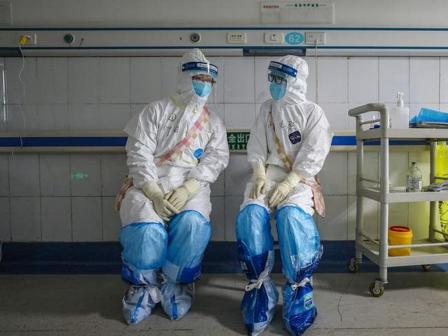 Doctors in China have begun dying of the disease. Picture: STR / AFP.