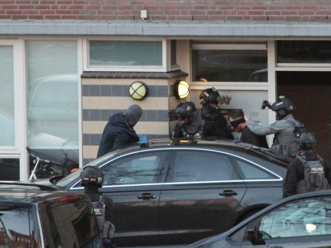 Gokmen Tanis is led away by police in Utrecht, Netherlands, Monday March 18, 2019, after a shooting incident on a tram which killed three people. Picture: AP