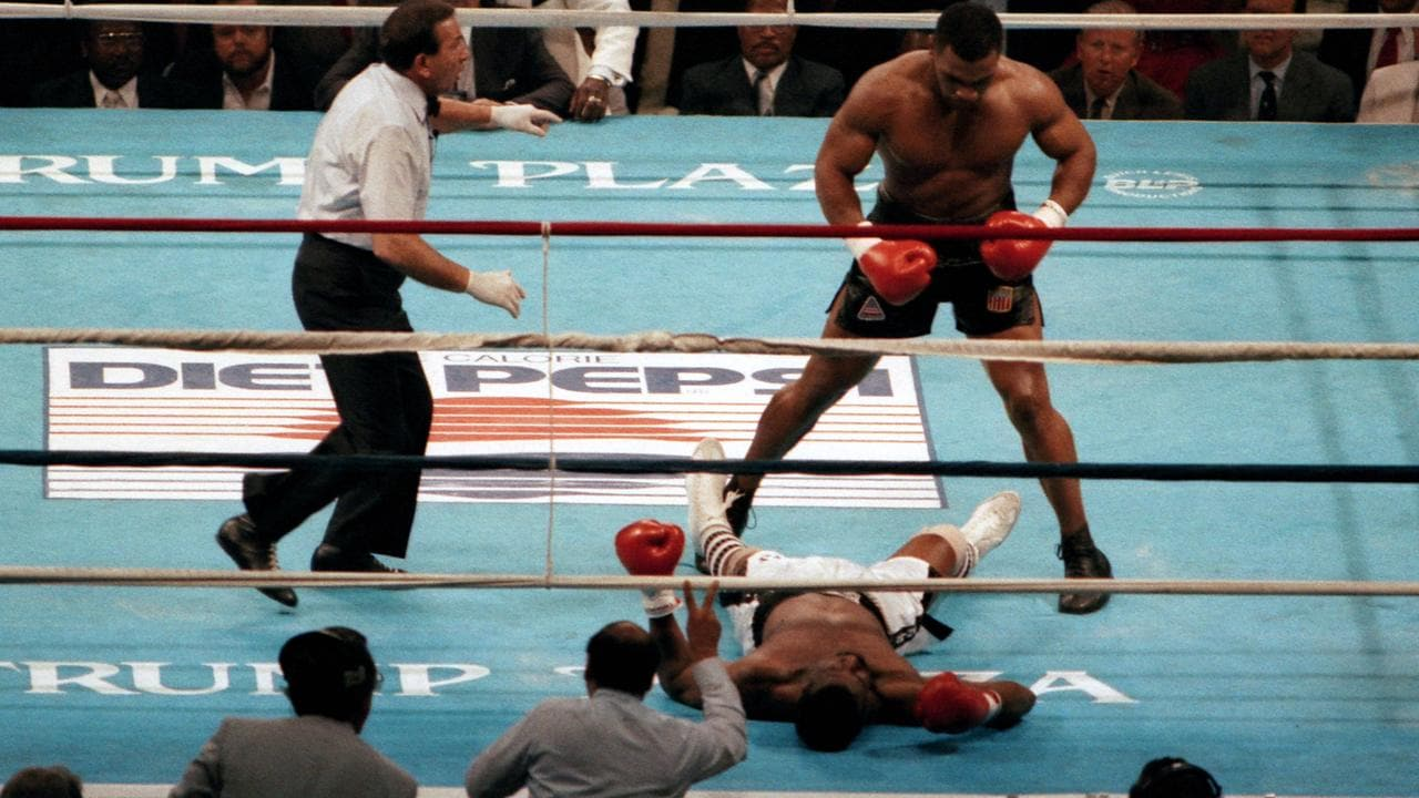 Tyson made light work of beating Michael Spinks.