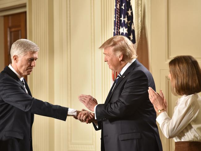 And the winner is... Judge Neil Gorsuch shakes hands with US President Donald Trump after he was nominated for the Supreme Court. Picture: AFP