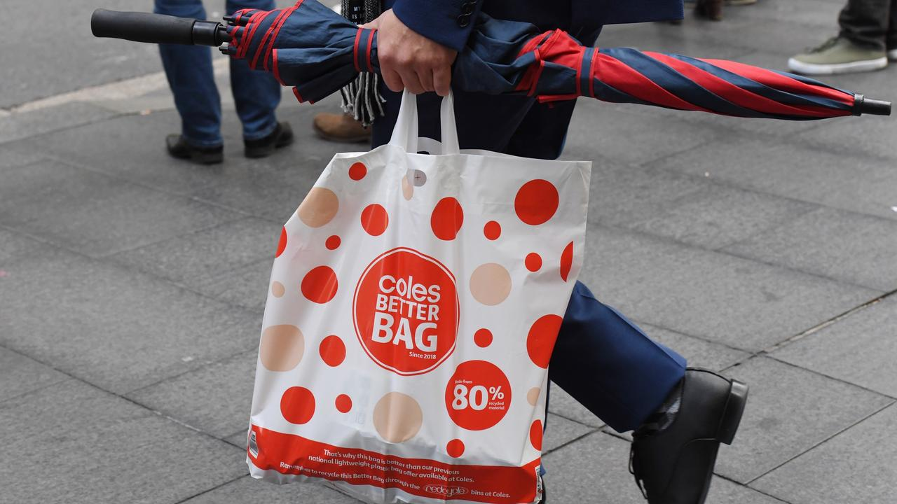 A shopper carrying a reusable plastic bag at a Coles store in July. Picture: AAP