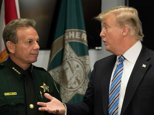 Mr Trump speaks with Broward County Sheriff Scott Israel following last week's deadly shooting. Picture: Jim Watson/AFP