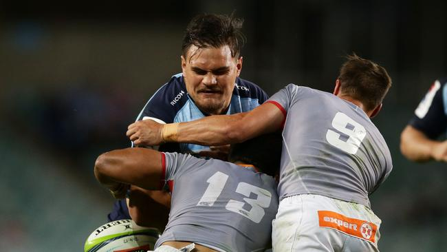 Angus Ta'avao of the Waratahs drops the ball in a tackle.