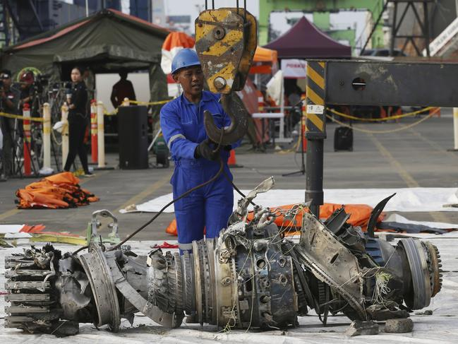 Officials move an engine recovered from the crashed Lion Air jet for further investigation. Picture: Achmad Ibrahim