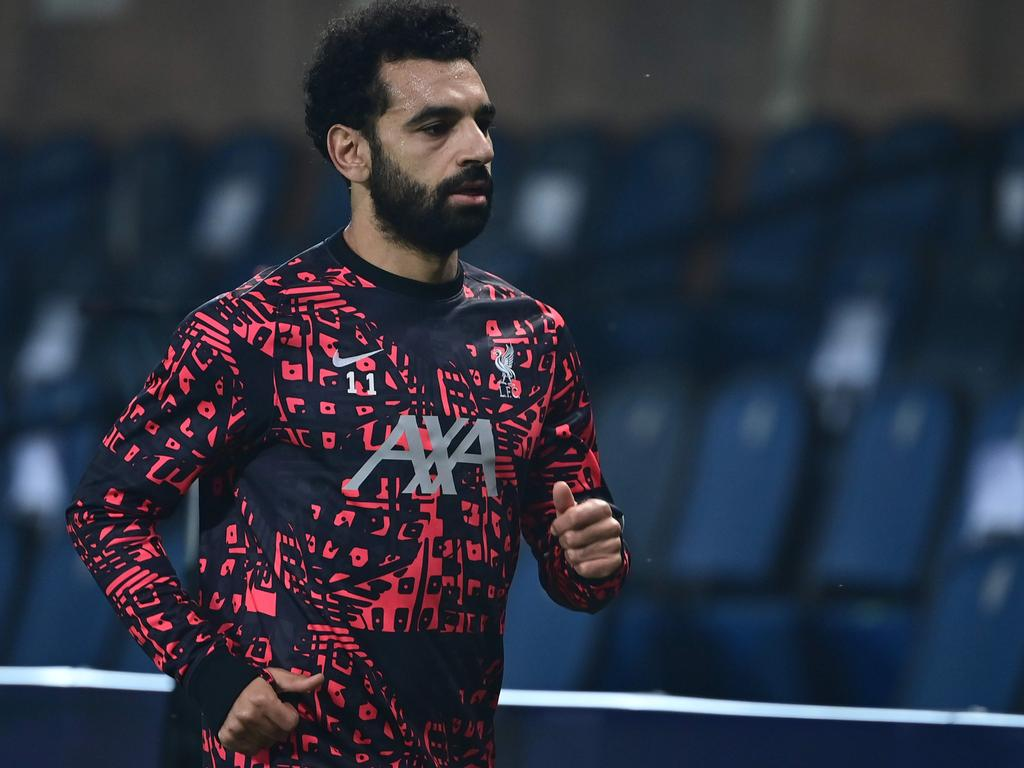 (FILES) A file photo taken on November 03, 2020 shows Liverpool's Egyptian midfielder Mohamed Salah warming up ahead of the UEFA Champions league football match Atalanta Bergamo vs Liverpool, at the Atalanta stadium in Bergamo. - Salah has tested positive for Covid-19 but without suffering any symptoms, the Egyptian Football Association announced on November 13, 2020. (Photo by MIGUEL MEDINA / AFP)