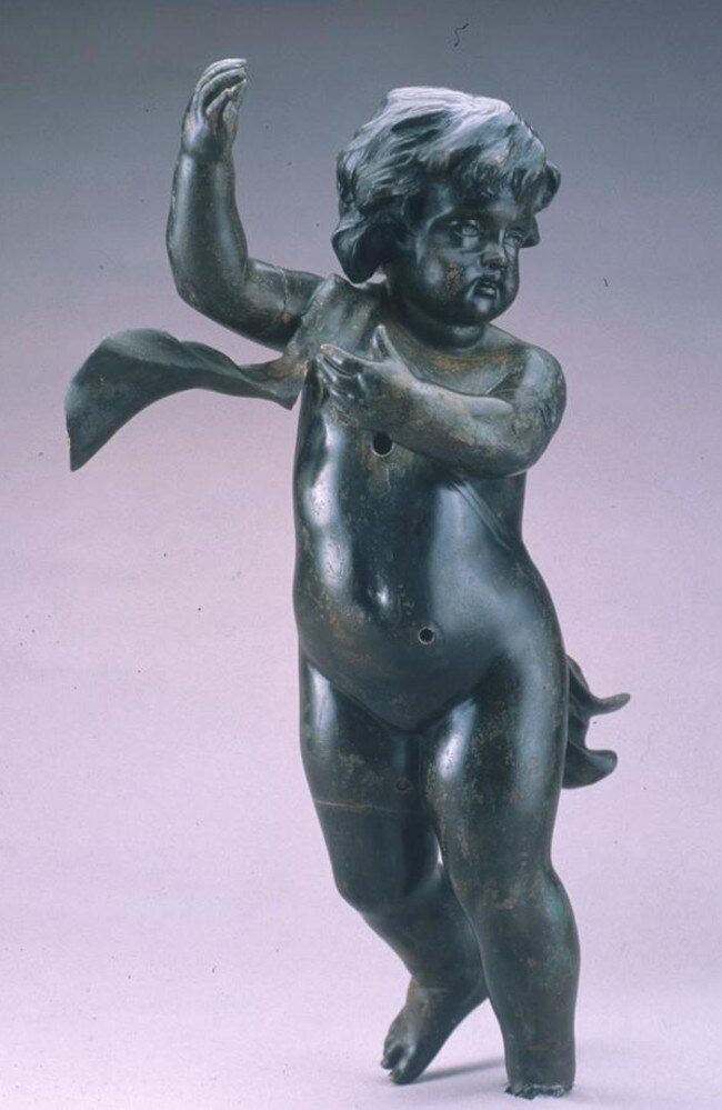 This bronze cherub was recovered in 1987 and is missing its left foot. This loss most likely occurred when the cherub was ripped from the staircase post it adorned. Each level of the staircase was decorated with inlaid wood and gilded ornaments. Picture: RMS Titanic, Inc.