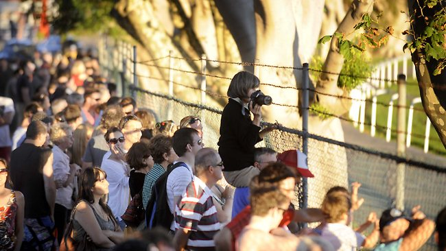 Crowds watch from outside the fence as Black Caviar wins again. Picture: Jeremy Piper