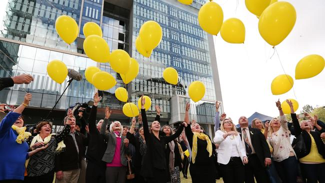 Supporters release yellow balloons after the verdict in the Baden-Clay murder trial. Picture: Jack Tran