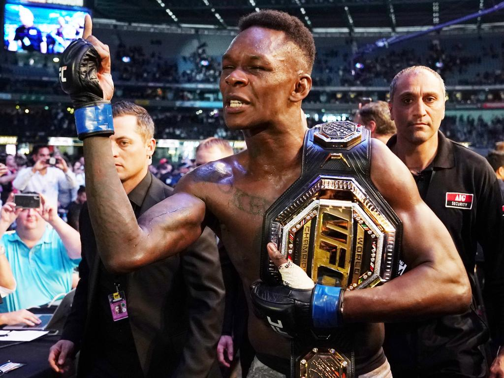 Israel Adesanya of New Zealand celebrates his win against Robert Whittaker of Australia during UFC 243 at Marvel Stadium in Melbourne, Sunday, October 6, 2019. (AAP Image/Michael Dodge) NO ARCHIVING,EDITORIAL USE ONLY