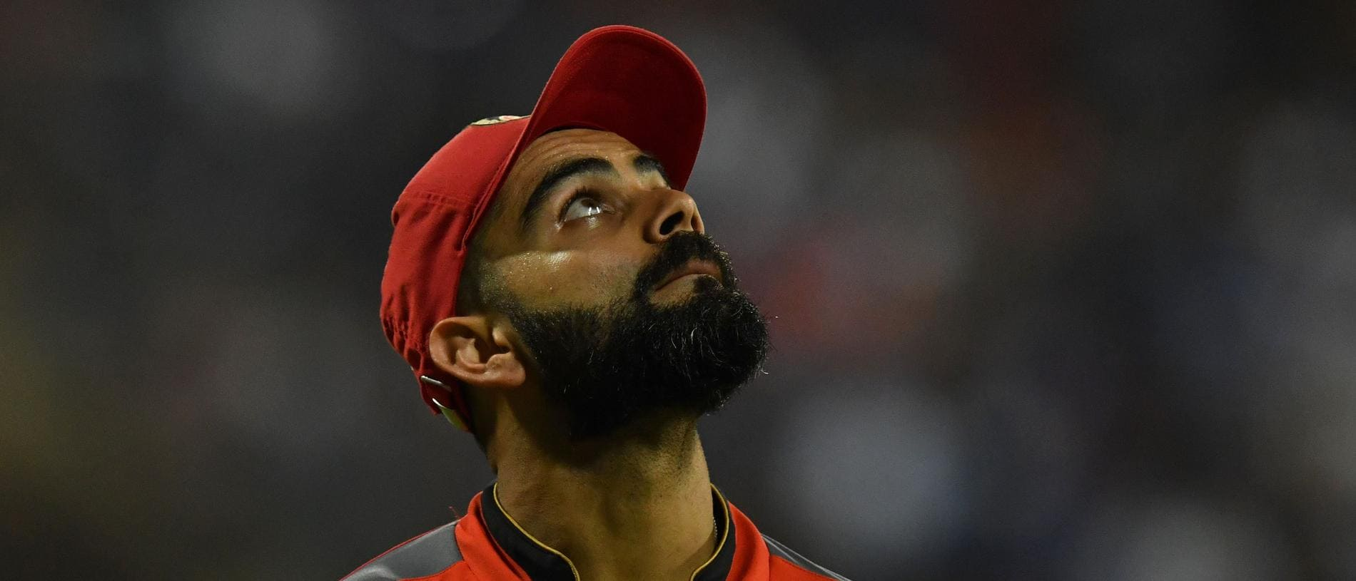 Royal Challengers Bangalore captain Virat Kohli looks on during the 2019 Indian Premier League (IPL) Twenty20 cricket match between Mumbai Indians and Royal Challengers Bangalore at the Wankhede Stadium in Mumbai on April 15, 2019. (Photo by Indranil MUKHERJEE / AFP) / ----IMAGE RESTRICTED TO EDITORIAL USE - STRICTLY NO COMMERCIAL USE----- / GETTYOUT