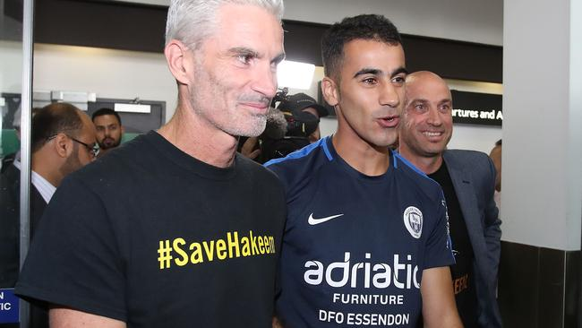 Hakeem Al-Araibi and Craig Foster arriving back in Australia. Picture: AAP